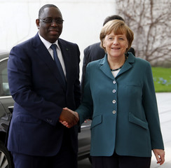 Senegal's President Sall is welcomed by German Chancellor Merkel upon his arrival at the Chancellery in Berlin