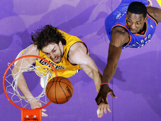 Los Angeles Lakers Pau Gasol fights for a rebound with Oklahoma City Thunder's Jeff Green during Game 2 of their NBA Western Conference playoff series in Los Angeles