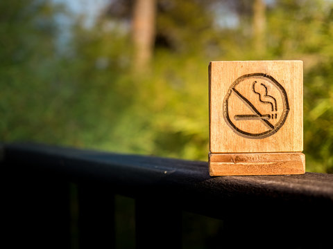 No smoking sign with nature background.
