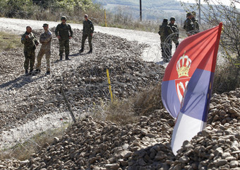 KFOR soldiers are seen near the barricades at the closed Serbia-Kosovo border crossing of Jarinje