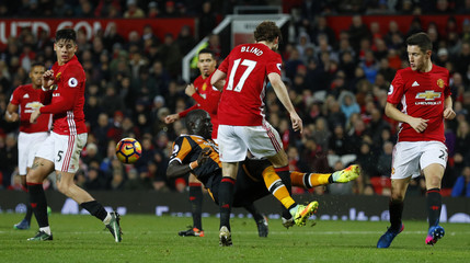 Hull City's Oumar Niasse in action with Manchester United's Daley Blind
