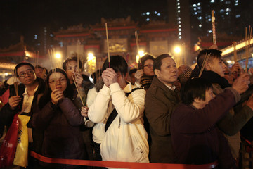 Devotees offer prayers at the Wong Tai Sin temple in Hong Kong