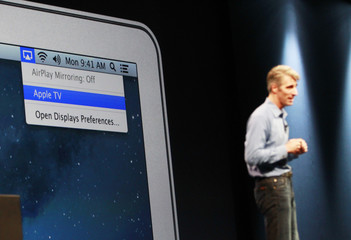 A screen shot showing the OS update menu for the new Apple TV is pictured as Craig Federighi, Apple Senior Vice President, Software Engineering, discusses the Mountain Lion OS during the Apple Worldwide Developers Conference 2012  in San Francisco