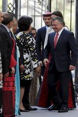 Jordan's King Abdullah (R), arrives with Jordan's Queen Rania (2nd R), and Crown Prince Hussein Amman