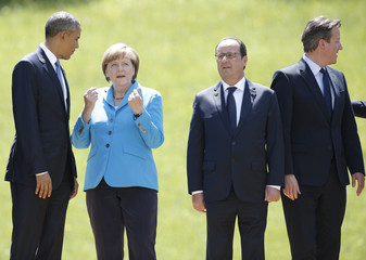 US President Obama, German Chancellor Merkel, French President Hollande and British PM Cameron prepare for a family photo during their meeting at the hotel castle Elmau in Kruen