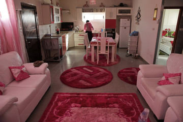 Bedouin woman works in the kitchen of her home in the 'unrecognised' village of Um Al-Hiram in southern Israel's Negev desert