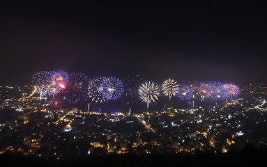Fireworks fly over houses at Jouniyeh city during the opening the International Festival of Jouniyeh, in north Beirut