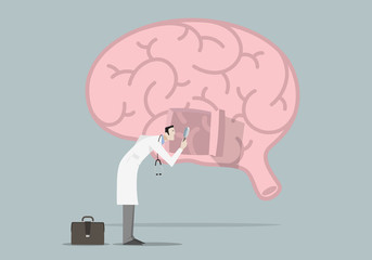 Brain Diseases Research Concept: Doctor with magnifying glass looking inside a brain.