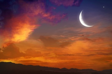 Generous Ramadan with mosque silhouettes . Ramadan background . Eid Mubarak background .Sunset and new moon .Paradise heaven