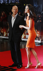 """Actor Bruce Willis and his wife Emma Heming  pose before the British premiere of """"A Good Day to Die Hard"""" at Leicester Square in London"""
