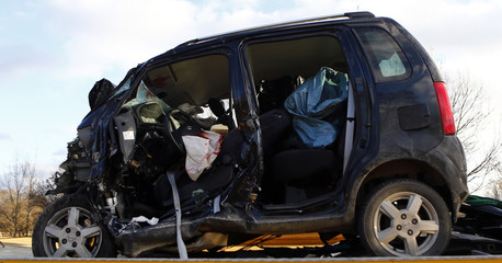 The car wreckage of a wrong-way driver is lifted on a towtruck on the highway A92 near Moosburg