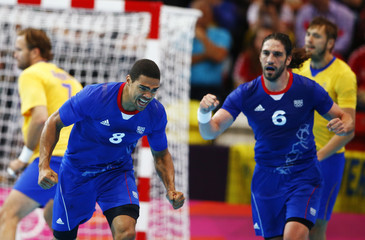 France's Daniel Narcisse celebrates a goal against Sweden in their men's handball Preliminaries Group A match at the Copper Box venue during the London 2012 Olympic Games