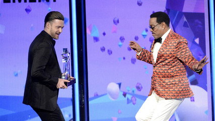 Justin Timberlake presents the lifetime achievement award to Charlie Wilson at the 2013 BET Awards in Los Angeles