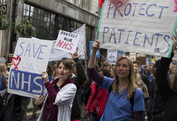Protesters hold banners at a demonstration in support of junior doctors in London, Britain