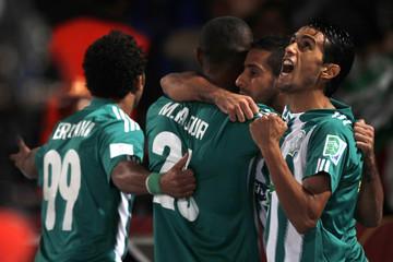 Raja Casablanca's Iajour celebrates his goal against Atletico Mineiro with his teammates during their FIFA Club World Cup semi-final match at Marrakech stadium