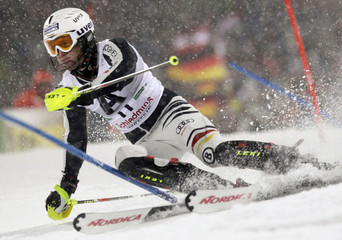 Fritz Dopfer of Germany clears a gate during the Alpine Skiing World Cup Slalom race in Schladming