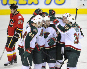 Minnesota Wild' Latendresse celebrates his goal with Prosser, Heatley, Koivu and Falk while Calgary Flames' Glencross skates in the background during their NHL hockey game in Calgary.