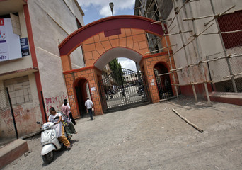 Student drives a scooter out of the Balbhim College for Art, Science and Commerce in Beed