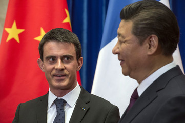 French Prime Minister Manuel Valls meets Chinese President Xi Jinping at the Great Hall of the People in Beijing