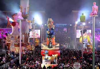 A float that portrays French President Francois Hollande makes it way through the crowd during the Carnival parade in Nice