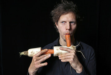 Austrian musician Matthias Meinharter, a member of the Vegetable Orchestra, poses for a picture with a musical instrument made from vegetables in Haguenau, eastern France