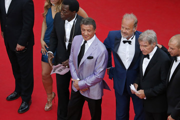 "Actor Sylvester Stallone and cast members of the film ""The Expendables 3"" pose on the red carpet during the 67th Cannes Film Festival in Cannes"