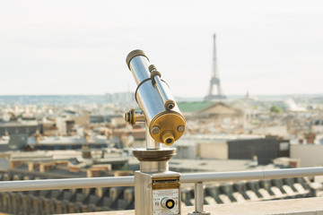 Telescope looking over the Eiffel Tower
