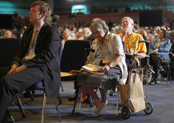 Delegates listen to Britain's Minister of Sate for Pensions Steve Webb speak during the Liberal Democrats annual autumn conference in Birmingham
