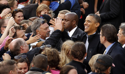 U.S. President Barack Obama greets supporters after speaking to an estimated crowd of 30,000 at a campaign rally in Madison
