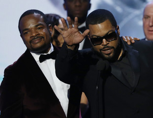 """Producer Ice Cube accepts the award for Outstand Motion Picture for """"Straight Outta Compton"""" with director F. Gary Gray at the 47th NAACP Image Awards in Pasadena"""
