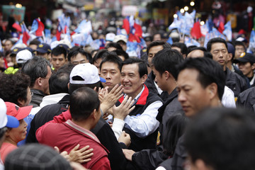 Taiwan President and KMT presidential candidate Ma shakes hands with supporters in New Taipei City