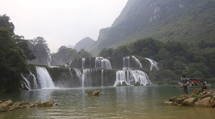 A tourist takes photo Ban Gioc waterfall which bordered with China, in Cao Bang province, Vietnam