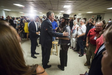 Republican presidential candidate and former Florida Governor Jeb Bush greets Rob Webber of Boston after speaking during a town hall event in Norfolk