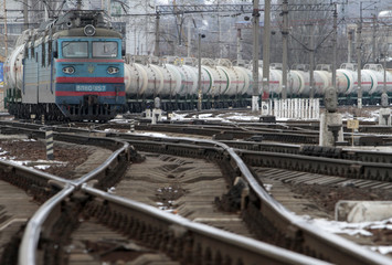 A freight train moves along railway lines in Kiev