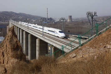 A high-speed train travels on the new Zhengzhou-Xi'an railway in Luoyang