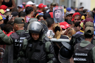 Supporters of Venezuela's President Nicolas Maduro rally outside the  National Assembly building in Caracas