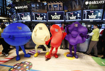 "Mascots dressed as characters from the mobile video game ""Candy Crush Saga"" pose during the IPO of Mobile game maker King Digital Entertainment Plc on the floor of the New York Stock Exchange"