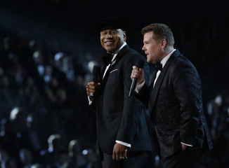 Host LL Cool J and Corden introduce a medley honoring Recording Academy Person of the Year Lionel Richie at the 58th Grammy Awards in Los Angeles