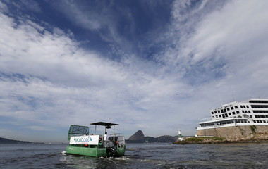Garbage-collecting boat is seen in front of Sugar Loaf mountain at Guanabara Bay in Rio de Janeiro, Brazil