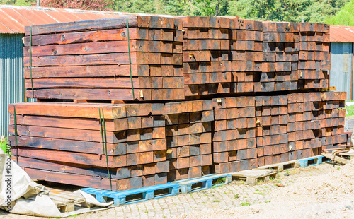 Stacked new and unused railroad ties or sleepers on pallets