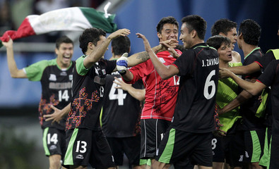 Mexico's players celebrate after winning their men's soccer gold medal match against Argentina at the Pan American Games in Guadalajara