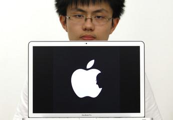 Hong Kong design student Jonathan Mak poses with a symbol he designed in Hong Kong