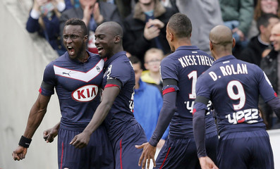 Bordeaux's Ludovic Sane celebrates with team mates after scoring against Paris St Germain during their French Ligue 1 soccer match at Chaban Delmas stadium in Bordeaux