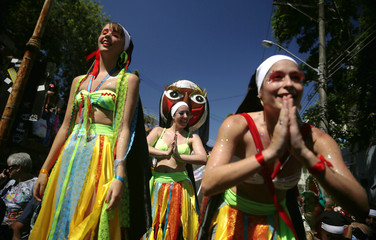 """Revellers take part in an annual block party known as """"Carmelitas"""", one of the many carnival parties to take place in the neighbourhoods of Rio de Janeiro"""