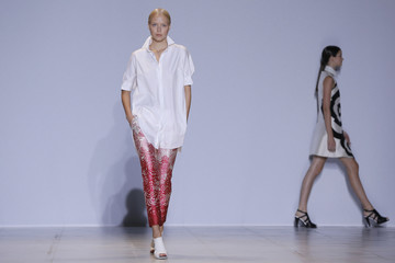 Models present creations by South Korean designer Lie Sang Bong as part of his Spring/Summer 2014 women's ready-to-wear collection during Paris Fashion Week