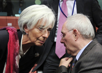 IMF President Lagarde talks to Germany's Finance Minister Schaeuble during an eurozone finance ministers' meeting in Brussels