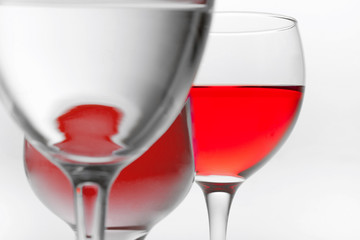 three glasses of red wine on it is white background and and place for text background