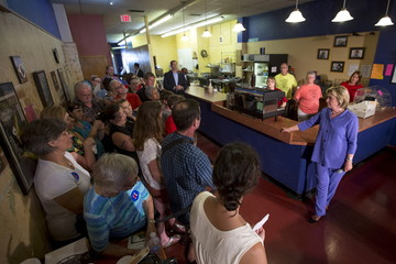 Democratic presidential candidate Hillary Clinton listens to audience questions during a campaign event at Uncle Nancy's Coffee in Newton, Iowa