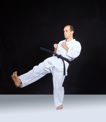 Blow leg athlete is beating on a black background