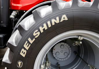 Logo of Belshina tire plant is seen on a tire of a tractor at the international agriculture exhibition in Minsk